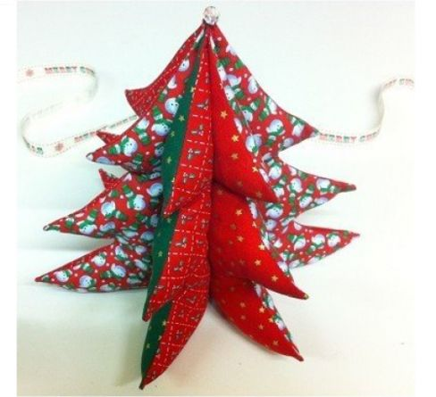 Lovely red and white Christmas tree sewing project made by stuffing a sewn ornament