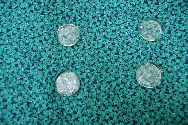 Pattern weights on a green fabric