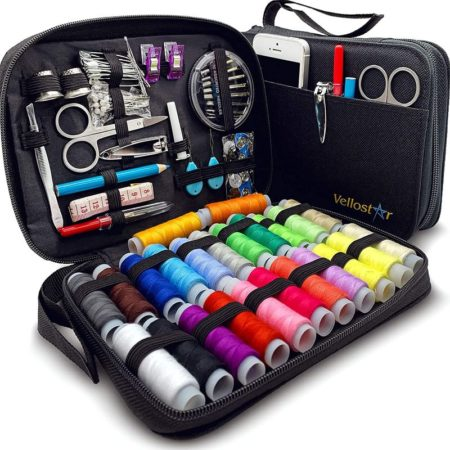 Black travel kit for sewists containing threads, scissors, and other sewing notions and sewing accessories