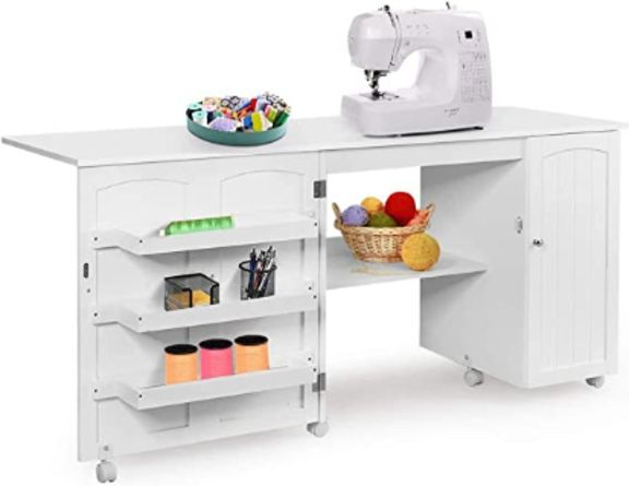 White foldable sewing cabinet with white sewing machine on it