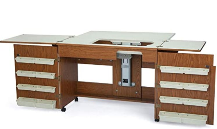 Brown and cream colored Arrow 700 Bertha Sewing Cabinet with foldable arms and foldable sides