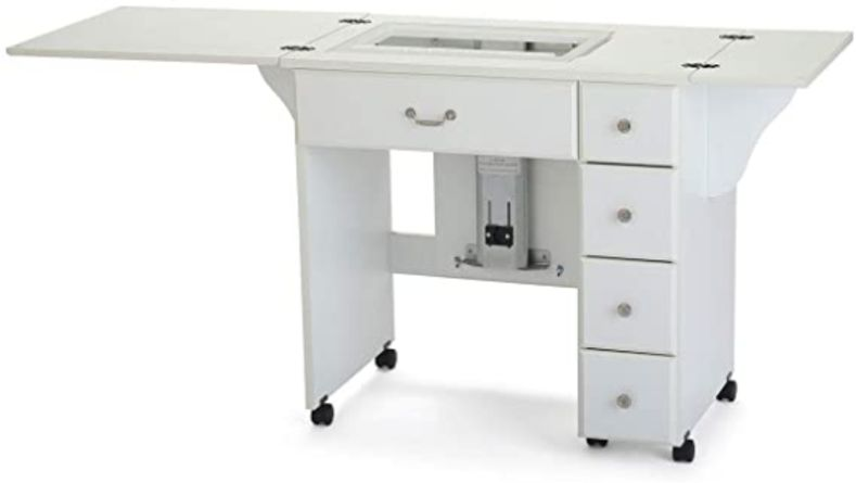 White sewing cabinet with foldable arm