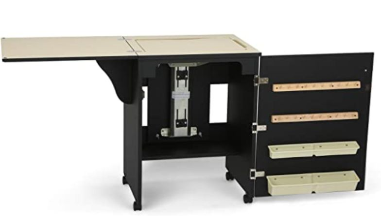 Black and Cream coloured Arrow Sewnatra Sewing Cabinet with airlift mechanism
