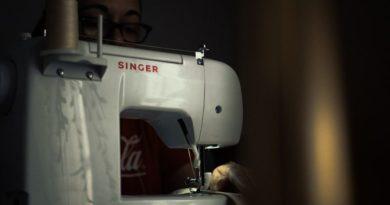singer sewing machine on a dark background