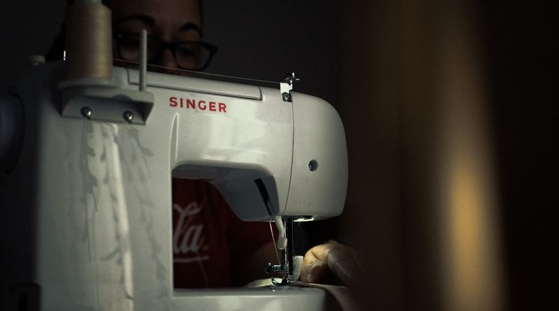 singer sewing machine on a dark background