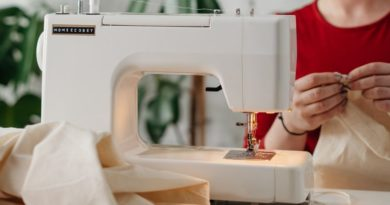 White Sewing machine on a sewing table
